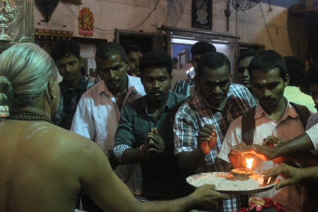 Worshippers rush to take part in the sacred fire custom at Sri Veeramakaliamman.