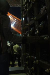 Worshippers ring the bells at the temple's doorway to announce their entry and exit to the gods.