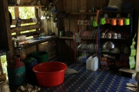 Simple reigns supreme in Rodiah's home. Red basin used for washing dishes.