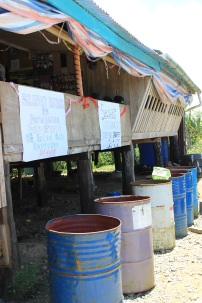 This is how villagers collect water for chores at their homes. The rain will dribble off the roof into these large barrels underneath.