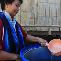 Auntie Rodiah Aling uses a small plastic pot like this to retrieve water from the rain barrels for small household chores.