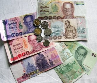 Throw it up, throw it up. All I see is ฿aht. Bhumibol Adulyadej Thai King Bhumibol Adulyade or Rama IX's face is all over the currency. Photo courtesy of www.pandintong.com