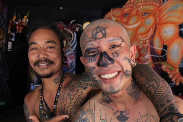 Tattoo artists on Kho Phi Phi in Thailand. On this small island, tattoo artists are the celebrities, often dripping from head to toe in permanent ink. Notice the MS-13 gang tattoo on the fellow on the right's face.