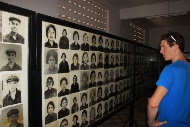 A tourist looks at all the victims of S-21. Prison officials catalogued every prisoner that entered the jail.