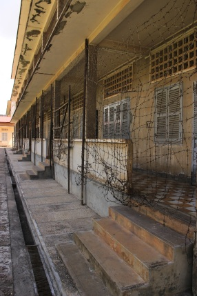 The reality of S-21, a former Khmer Rouge prison in Phnom Penh. Each small room is a cell that used to house prisoners.