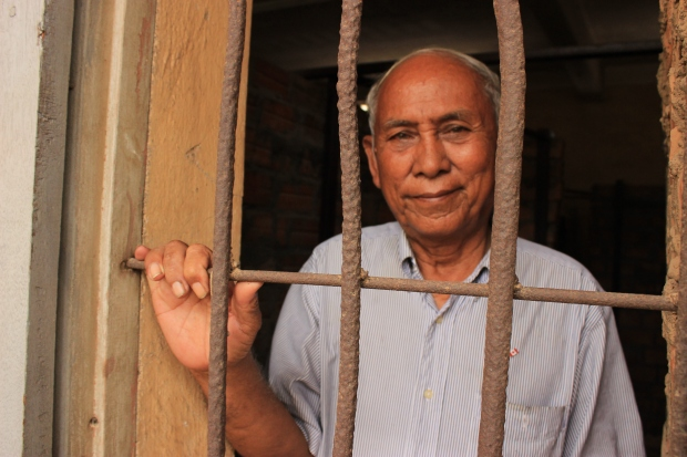 Imprisoned memories. Chum Mey stands inside the exact same cell that held him captive in 1978 & 1979 at the Khmer Rouge's Tuol Sleng prison.