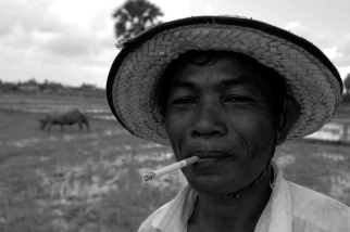 This Cambodian farmer takes a break during a muggy spring morning outside Siem Reap.