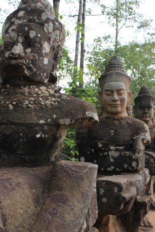 Close-up of the figures built into Angkor Thom's bridge.