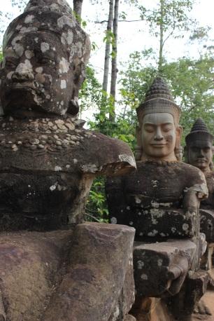 Close-up of the figures built into Angkor Thom's bridge.