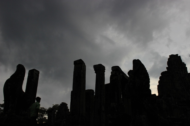 Sunset at Angkor Thom. A tour group scrambles to see the ruins before dark.