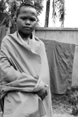 Many orphan or abandoned boys enter the monastery at a young age. This young man likely falls into that category.