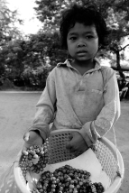 Outside some of the temples at Ta Prohm, this little girl sold me two bracelets. She's maybe four or five.