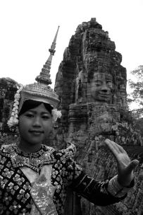 A woman dressed in traditional Cambodian dance-wear at Angkor Thom in Cambodia.