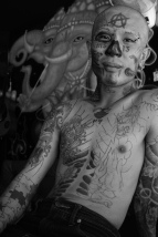 Skin deep. Phi Phi has a rich tattoo tourism industry & the artists don't disappoint. Notice the MS-13 gang signs near his nose.