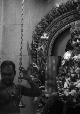 A priest performs a ceremony in front of the goddess Kali that Sri Veeramakaliamman Hindu temple in Singapore is dedicated to.