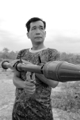 """This man, reportedly named, """"Number Two,"""" is a curator of a military weapons range in Cambodia."""