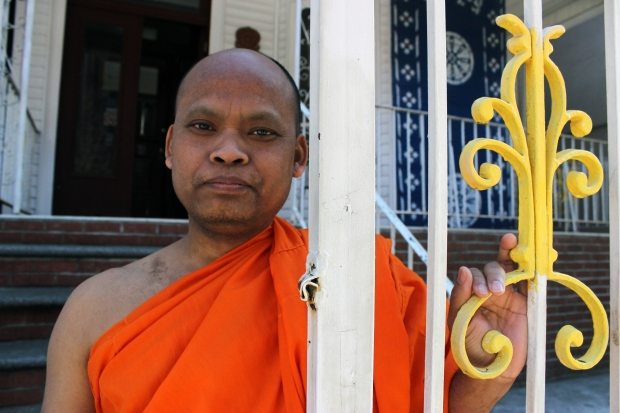 Venerable Kandaal Pheach stands outside the gateway to Wat Jotanaram, a Cambodian Buddhist temple in the Bronx that has a rich & endearing history. Pheach is concerned about the temple's future.